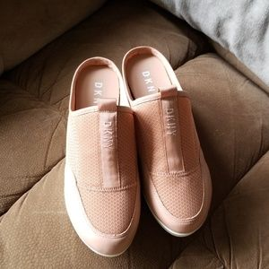 DKNY slip on wedge sneaker in a blush nude color